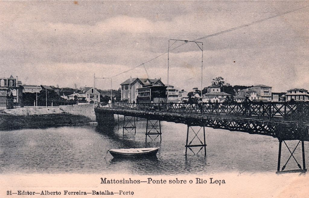 The iron bridge across the river Leça with one of the oldest tramcars after it was electrified